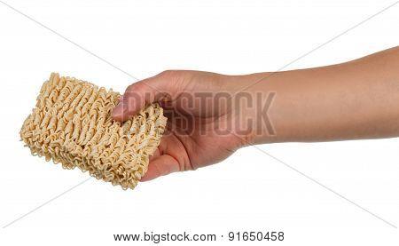 Ramen noodles in female hand