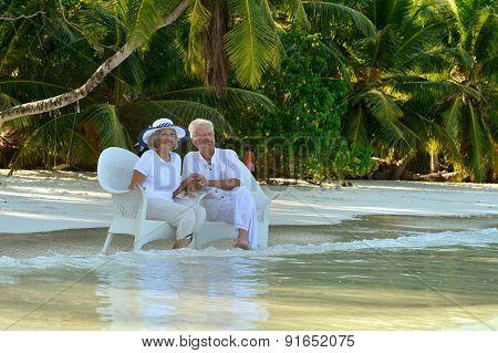 Elderly couple sitting