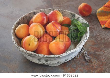 Fresh whole wet apricots, close up