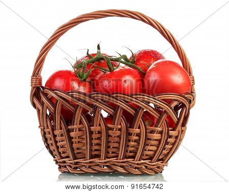 Tomatoes in basket on white