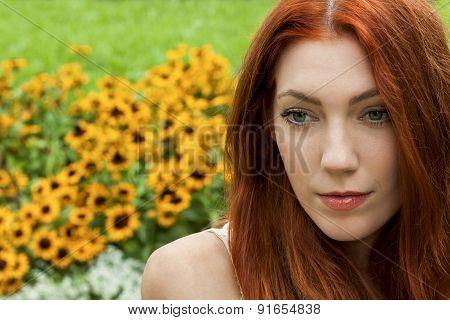 Long Hair Woman At The Garden Looking Afar