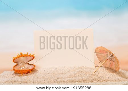 Blank card, an umbrella and a shell