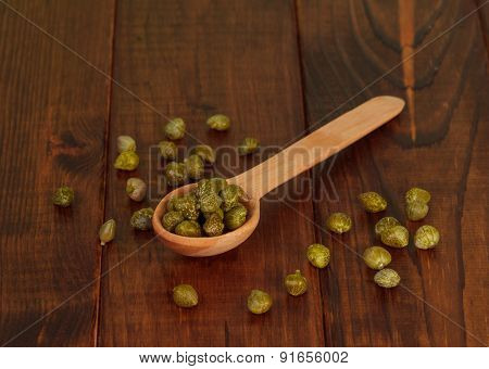 Green olives on the spoon