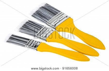 Three Paint Brushes Of Different Sizes With Yellow Handle