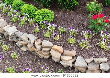 Natural Rock Retaining Wall In A Garden