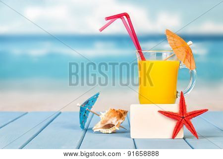 Glass of juice and a card