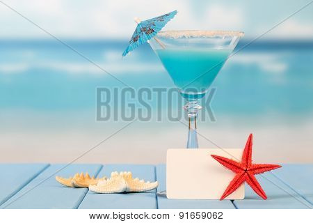 Cocktail with umbrella and starfishes