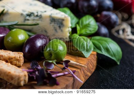 Food Background,rustic Board With Cheese Herbs And Grapes