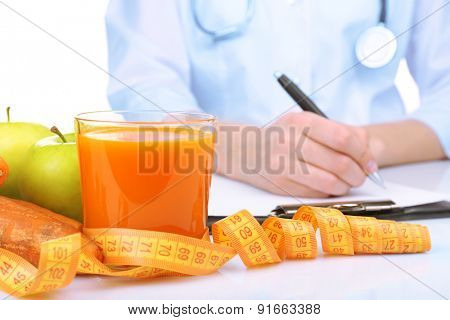 Nutritionist Doctor writing diet plan, closeup