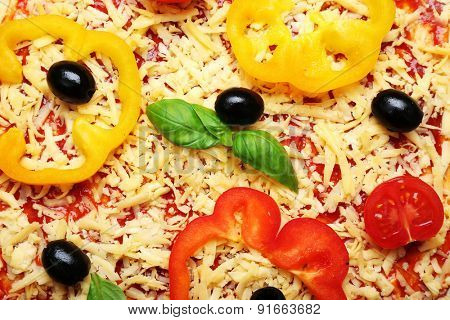 Raw pizza with vegetables close up