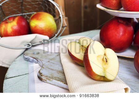 Tasty ripe apples on table close up