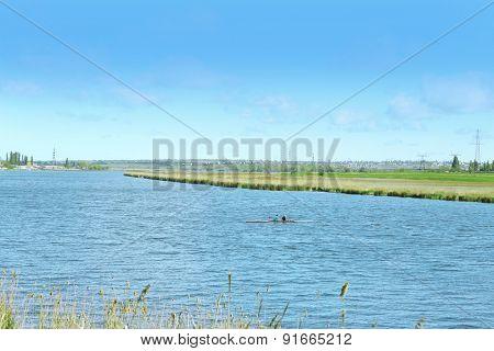 River bank over blue sky background