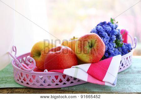 Beautiful bouquet of muscari - hyacinth with fruits on metal tray on windowsill