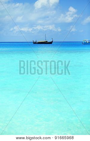 View of beautiful blue ocean water with ship in resort