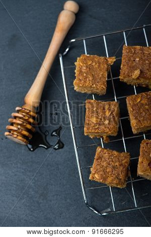 Homemade Healthy Flapjacks With Honey On Cooling Rack