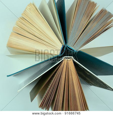 Group of books on light blue background, top view