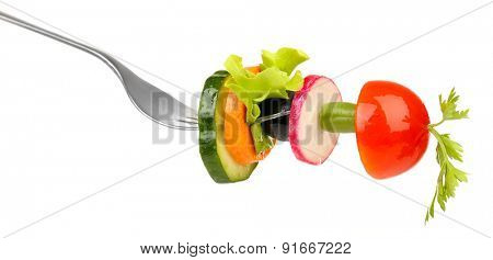 Different vegetables on fork isolated on white