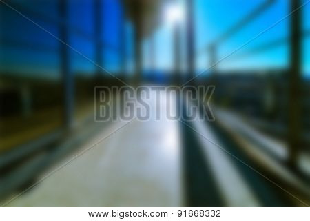 Modern industrial Construction with blue sky and sun, blurred background