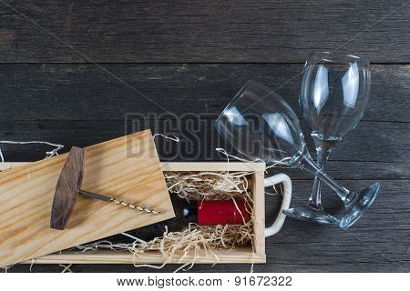 Vintage Wooden Wine Case With Bottle And Glass On Rustic Background