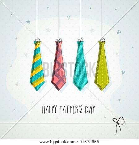 Hanging colorful neck-ties on stars decorated grey background, greeting card design for Happy Father's Day celebrations.