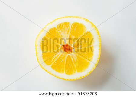 fruits, citrus, diet and objects concept - ripe orange or lemon slice over white