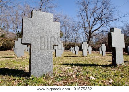 Cemetery with crosses in the same gray autumn