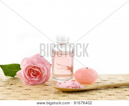Set of rose with candle and salt in spoon ,oil on mat
