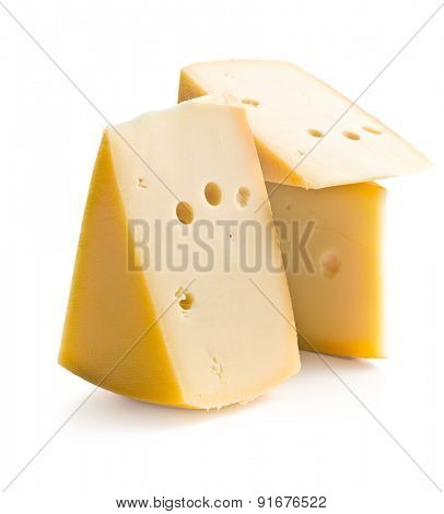 block of edam cheese on white background
