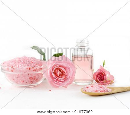 Spa setting with rose with salt in bowl ,oil