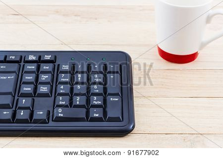 Image Of The Keyboard And A Glass Of Water.