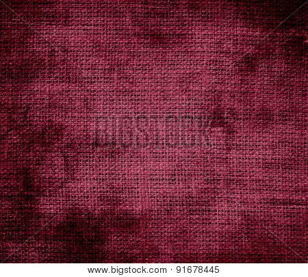 Grunge background of claret burlap texture
