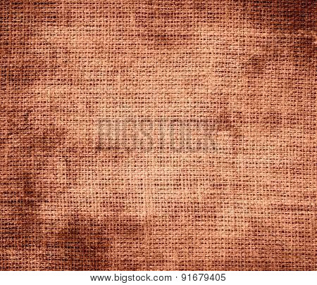 Grunge background of copper (crayola) burlap texture