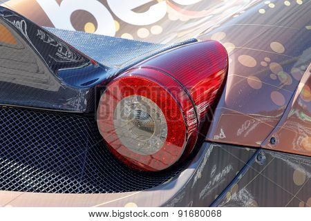 Taillight On A Fast Sports-car Before The Start Of The Public Event Gumball 3000