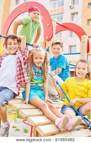 Little friends spending leisure on playground
