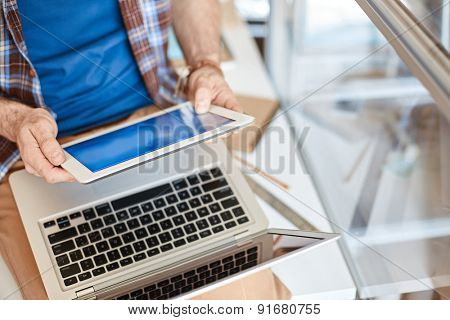 Young businessman using modern gadgets