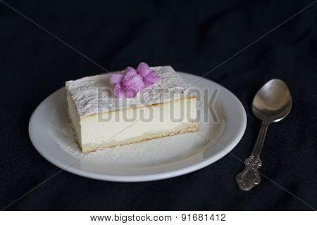 Slice Of Cheesecake On A Dark Surface