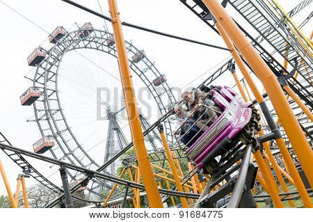 Roller Coaster And Large Ferris Wheel Prater Vienna
