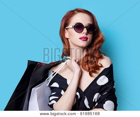 Girl In Black Dress With Shopping Bags