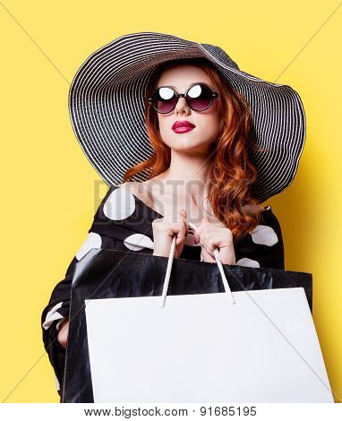 Girl In Black Dress And Hat With Shopping Bags