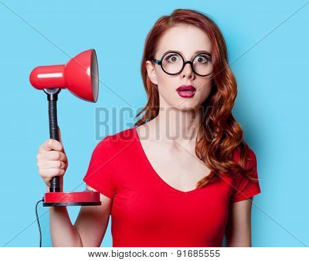 Girl In Red Dress With Lamp