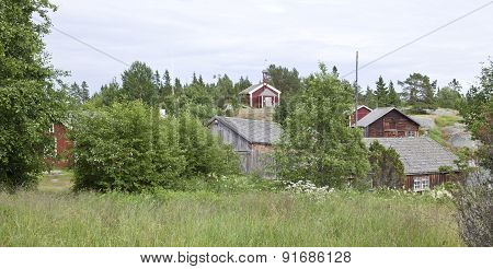 Several wooden buildings by the Baltic Sea.