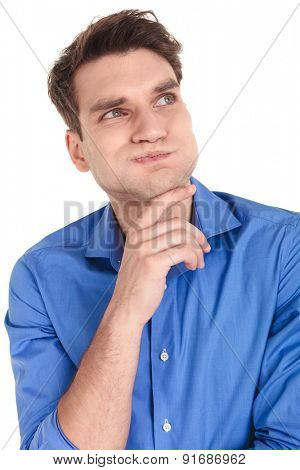 Casual young man making a funny face while looking away from the camera