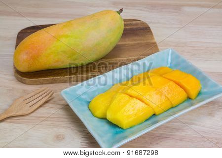 Mango On A Wooden Background