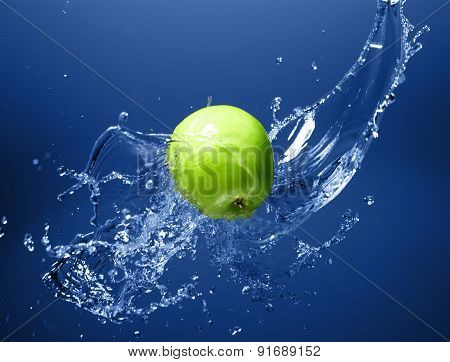 Green Apple With Water Splash, On Blue Water