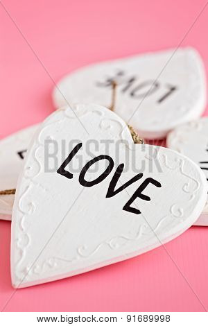 Love Wooden White Heart On Pink Background