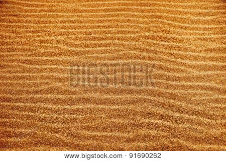 closeup of a sand background with a natural wavy pattern