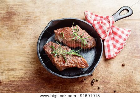 Steaks on cast iron frying pan