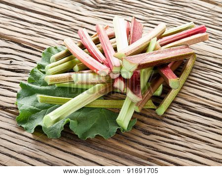Rhubarb stalks on the wooden table.