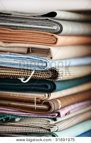 Stack Of Assorted Folded Fabrics