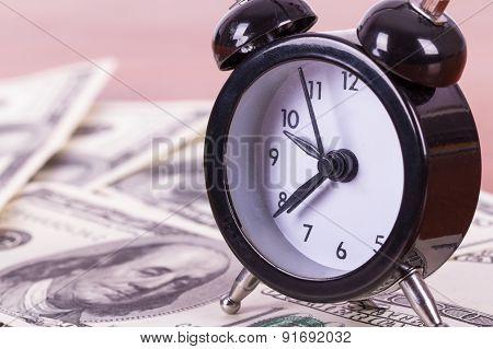 Alarm Clock And Banknotes